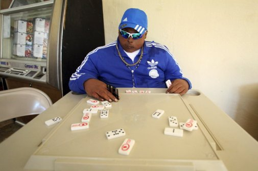 Image #: 40220722 The dead body of Jomar Aguayo is seated at a table with domino tiles and with a condom placed in one of his hands in San Juan, October 19, 2015. Aguayo's family decided, with the help of a funeral home that specializes in embalming techniques, to have him sit at a table at his mother's bar for the wake. Aguayo was 23 years old when he was shot dead during a shootout, according to local media. REUTERS/Alvin Baez /LANDOV TPX IMAGES OF THE DAY