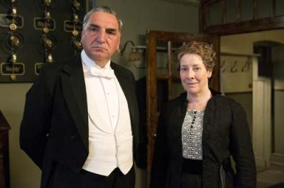 This undated publicity photo released by Masterpiece shows Jim Carter, left, as Carson and Phyllis Logan as Mrs. Hughes, in ÒDownton Abbey,Ó series 3. The show is nominated for outstanding drama series at Sunday's 65th Primetime Emmy Awards. (AP Photo/Masterpiece, Giles Keyte/Carnival Films)
